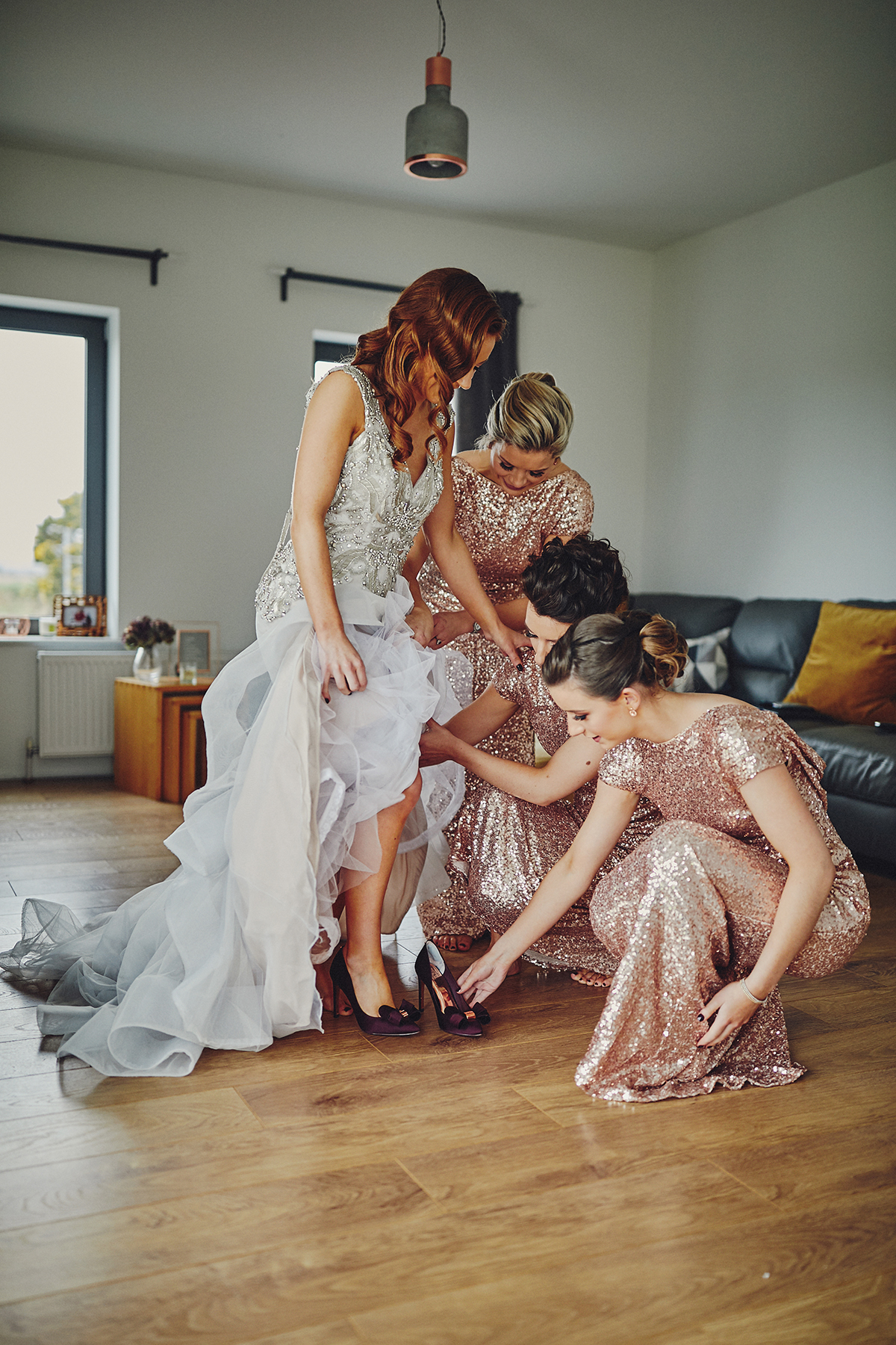 Bridemaids helping Bride